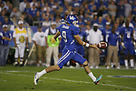 UK kicker Ryan Tydlacka punts the ball against Auburn at Commonwealth Stadium on Saturday, Oct. 9, 2010. Photo by Scott Hannigan | Staff