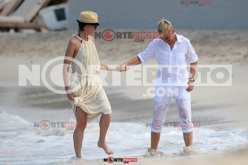 PAP1212PA359.ELLEN DE GENERES  AND PORTA DE ROSSI STROLLING IN ST JEAN'S BEACH AFTER LUNCH AT THE EDEN ROCK RESTARANTU..ELLEN DE GENERES  AND PORTA DE ROSSI STROLLING IN ST JEAN'S BEACH AFTER LUNCH AT THE EDEN ROCK RESTAURANT.ELLEN DE GENERES  AND PORTA DE ROSSI STROLLING IN ST JEAN'S BEACH AFTER LUNCH AT THE EDEN ROCK RESTAURANT