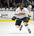 "19 January 2007: University of Vermont forward and co-captain Torrey Mitchell from Greenfield Park, QC, in action against Boston College at Gutterson Fieldhouse in Burlington, Vermont. The UVM Catamounts defeated the BC Eagles 3-2 before a record setting 50th consecutive sellout at ""the Gut""...Mandatory Photo Credit: Ed Wolfstein Photo."