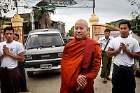 Supporters of U Wirathu, the spiritual leader of the Buddhist nationalist 969 Movement bow in reverence as Wirathu arrives at a service in which he gives awards to young students at the Aye Thaka Monastery in Mandalay. U Wirathu is an abbot in the New Maesoeyin Monastery where he leads about 60 monks and has influence over more than 2,500 residing there. He travels the country giving sermons to religious and laypeople encouraging Buddhists to shun Muslim business and communities. /Felix Features