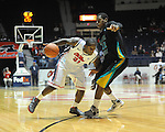 "Ole Miss' Murphy Holloway (31) vs. Coastal Carolina's Michael Enanga (12) at the C.M. ""Tad"" Smith Coliseum in Oxford, Miss. on Tuesday, November 13, 2012. (AP Photo/Oxford Eagle, Bruce Newman)"