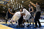 17 December 2013: Referee Maj Forsberg (right) calls for a jump ball as UConn's Stefanie Dolson (center) is tied up by Duke's Elizabeth Williams (1) and Alexis Jones (right) as UConn's Morgan Tuck (3) and Breanna Stewart (30) watch. The Duke University Blue Devils played the University of Connecticut Huskies at Cameron Indoor Stadium in Durham, North Carolina in a 2013-14 NCAA Division I Women's Basketball game. UConn won the game 83-61.