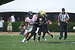Vanderbilt quarterback Larry Smith (10) is chased by Ole Miss' Mike Marry (52) in Nashville, Tenn. on Saturday, September 17, 2011. Vanderbilt won 30-7..