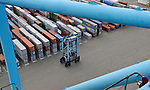Container carries are used to stack containers at the APM Terminal at the Port of Rotterdam, on Tuesday Oct. 27, 2009, in Rotterdam, the Netherlands. (Photo © Jock Fistick)
