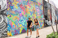 "Visitors in front of Plasmaburg's mural in Bushwick, Brooklyn in New York during the annual Bushwick Collective Block Party on Saturday, June 4, 2016. Music and partying brought some but the real attraction was the new murals  by ""graffiti"" artists that decorate the walls of the buildings that the collective uses.  (© Richard B. Levine)"