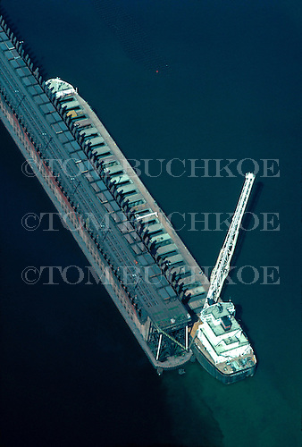 Aerial photo of the bulk freighter Charles E Wilson loading iron ore pellets at the Lake Superior and Ishpeming Railroad Ore Dock, in Marquette, Michigan on Lake Superior. Owned by the American Steamship Co, it's name was changed to the John J. Boland in 2000.