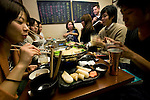 Customers enjoy Fukushima hotpot at 47 Dining, a restaurant specializing in Fukushima cuisine and promoting produce from the stricken prefecture, in Tokyo,  Japan on 13 Nov. 2012. Photographer: Robert Gilhooly