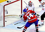 10 February 2010: Montreal Canadiens' center Tomas Plekanec scores the game winning goal against the Washington Capitals at the Bell Centre in Montreal, Quebec, Canada. The Canadiens defeated the Capitals 6-5 in sudden death overtime, ending Washington's team-record winning streak at 14 games. Mandatory Credit: Ed Wolfstein Photo