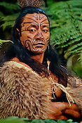 Maori man in kiwi cloak with Moko facial tatooes, Rotorua, New Zealand