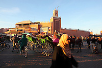 Shoppers and horse and cart in Djemma el Fna square and marketplace, Medina, Marrakech, Morocco. Picture by Manuel Cohen