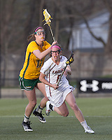 Boston College defender Kate Collins (6) on the attack as University of Vermont attacker Sydney Mas (17) defends. Boston College defeated University of Vermont, 15-9, at Newton Campus Field, April 4, 2012.