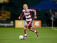 Brek Shea (20) of FC Dallas carries the ball up the field at RFK Stadium in Washington DC.   Dallas FC fell to D.C. United, 4-1.