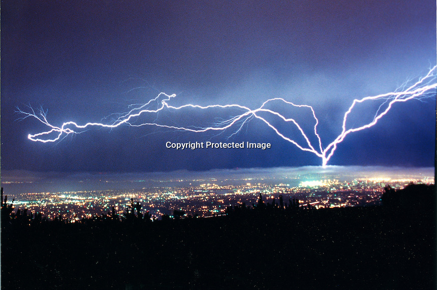 Lightning storm over the San Francisco-Oakland Bay Area. Lightning unusual for California hit the Bay Area on September 8, 1999. (photo copyright 1999 by Ron Riesterer)