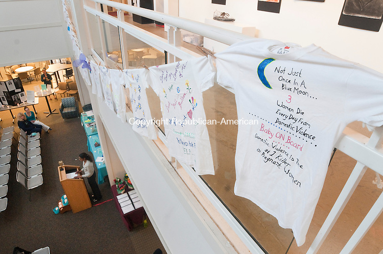WINSTED, CT--042315JS09- T-shirts from the Clothesline Project hang from the balcony, during the Susan B. Anthony Project's seventh annual Sexual Violence Awareness Month vigil Thursday at Northwestern CT Community College in Winsted. The event, which honors survivors, brings awareness and encourages people to be involved in speaking up against this community issue,  was co-sponsored by Connecticut Sexual Assault Crisis Services, Inc. <br /> Jim Shannon Republican-American