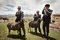 Kyrgyz herders adore their smartphones, which they acquire by bartering and keep charged with solar panels. The gadgets, which first appeared in the Afghan Pamir in 2010, are useless for communication?cellular service doesn't reach the isolated plateau?so they're used to play music and take photos. Phones, like all imported goods in the Pamir, are brought on the back of yaks or horses...Wedding celebration at Kitshiq Aq Jyrga...Trekking through the high altitude plateau of the Little Pamir mountains (average 4200 meters) , where the Afghan Kyrgyz community live all year, on the borders of China, Tajikistan and Pakistan.