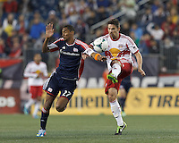 New York Red Bulls defender Heath Pearce (3) clears the ball as New England Revolution substitute forward Jerry Bengtson (27) pressures. In a Major League Soccer (MLS) match, the New England Revolution (blue) tied New York Red Bulls (white), 1-1, at Gillette Stadium on May 11, 2013.