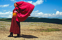 Young monk in the grasslands, Qinghai, China, 2007