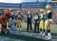 """Former Packers Willie Wood and Paul Hornung serve as Honorary Co-Captains of the NFC Championship game between the Packers and the Carolina Panthers at Lambeau Field on January 12, 1997. This was the first title game in Green Bay since the """"Ice Bowl"""" in 1967."""