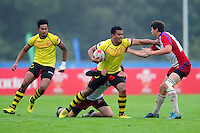 Amirul Sani of Malaysia takes on the Czech Republic defence. FISU World University Championship Rugby Sevens Men's 7th/8th/9th place match between the Czech Republic and Malaysia on July 9, 2016 at the Swansea University International Sports Village in Swansea, Wales. Photo by: Patrick Khachfe / Onside Images