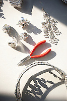 A pair of red pliers sits among jewelry designed by jeweler-to-the-stars Rodrigo Otazu on a table in New York, 8 November 2009.
