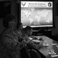 A member of staff gives a briefing about the Ballistic Missile Early Warning System designed to detect and track intercontinental ballistic missiles launched against North America at a meeting with base commander Joseph L. Prue and the Danish Minister of Defence Nicolai Wammen (both off camera). Thule Air Base was established as an American military base in 1951 and is the US Air Force's northernmost base. During the cold War it employed over 10,000 people, mainly serving as a landing and refuelling strip for American bombers, lying halfway between the US and the Soviet Union's industrial heartland via the North Pole. Today, around 550 people work at the base with another 400 Danish and Greenlandic civilian staff.