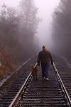 Man and his dog walking along the railroad tracks, Auburn California