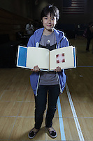 New York, NY, USA - June 24, 2011: Esmé Cribb, original Origami designer and folder from Brooklyn at the OrigamiUSA Convention in New York City holding a book of tessellations she created