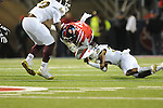 Ole Miss running back Jeff Scott (3) vs. Mississippi State defensive lineman Denico Autry (90) and Mississippi State defensive back Jay Hughes (30) at Vaught-Hemingway Stadium in Oxford, Miss. on Saturday, November 24, 2012. Ole Miss won 41-24.