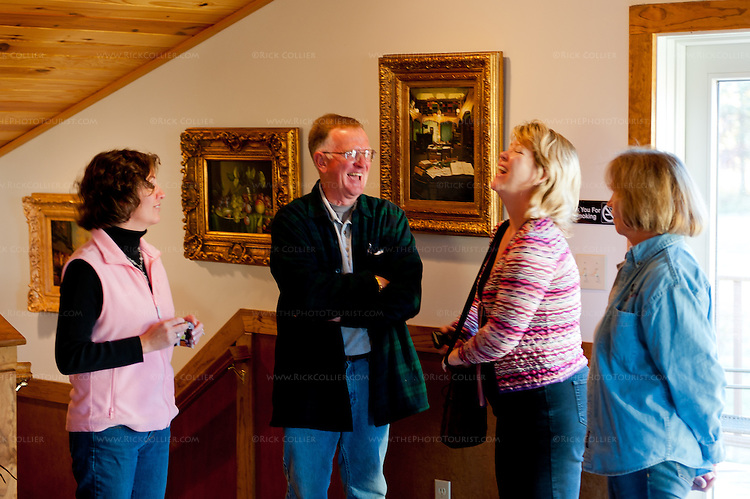 Nancy laughs with owners Al and Cheryl Kellert and their daughter in the loft area at Gray Ghost Vineyards.