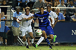 19 September 2014: Duke's Sean Davis (6) is defended by North Carolina's Tyler Engel (8) and Omar Holness (JAM) (behind). The Duke University Blue Devils hosted the University of North Carolina Tar Heels at Koskinen Stadium in Durham, North Carolina in a 2014 NCAA Division I Men's Soccer match. Duke won the game 2-1.