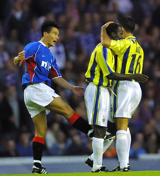 Rangers v Fenerbache 8.8.01: Michael Mols loses it and kicks out at Johnston to earn a red card.