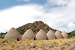The Ward Charcoal Ovens are located in the Egan Mountain Range, 18 miles south of Ely, Nevada. The ovens were built in 1876 to provide high quality charcoal to the nearby smelters for processing silver ore. Each oven could hold 35 cords of wood and would produce 30-50 bushels of charcoal per cord. It is speculated that the charcoal ovens remained in use until 1879 when the nearby smelter shut down. Photographed 08/07