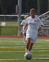 Boston Aztec midfielder Alexa St. Martin (20) brings the ball forward.  In a Women's Premier Soccer League (WPSL) match, Boston Aztec (white) defeated Seacoast United Mariners (blue), 2-1, at North Reading High School Stadium on Arthur J. Kenney Athletic Field on on June 23, 2013. Due to injuries through the season, Seacoast United Mariners could only field 10 players.