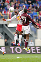 Dane Richards (19) of the New York Red Bulls and Luis Zapata (21) of the Colorado Rapids go up for a header. The New York Red Bulls defeated the Colorado Rapids 4-1 during a Major League Soccer (MLS) match at Red Bull Arena in Harrison, NJ, on March 25, 2012.