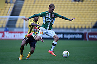 Jacob Pepper and Kenny Cunningham in action during the A League - Wellington Phoenix v Newcastle Jets Game at Westpac Stadium, Wellington, New Zealand on Sunday 26 October 2014. <br /> Photo by Masanori Udagawa. <br /> www.photowellington.photoshelter.com.