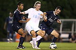 02 October 2012: Andy Craven (10) is defended by Georgia Southern's Chase Park (left) and Aleksandar Tomic (AUS) (7). The University of North Carolina Tar Heels defeated the Georgia Southern Eagles 2-0 at Fetzer Field in Chapel Hill, North Carolina in a 2012 NCAA Division I Men's Soccer game.