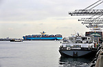 "The ""Elly Maersk"" departs from the APM Terminal at the Port of Rotterdam, on Tuesday Oct. 27, 2009, in Rotterdam, the Netherlands. The ""Elly Maersk"" one of eight PS-class container ships in the Maersk Line fleet,  and is one of the largest container vessels in the world. With an overall length of 397 meters and a width of 56 meters, it is capable of carrying 11,000 TEU (Twenty foot Equivalent Unit - a 20 foot long container). (Photo © Jock Fistick)"