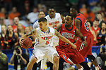 Florida's Scottie Wilbekin (5) vs. Ole Miss' Derrick Millinghaus (3) in the SEC championship game at Bridgestone Arena in Nashville, Tenn. on Sunday, March 17, 2013.