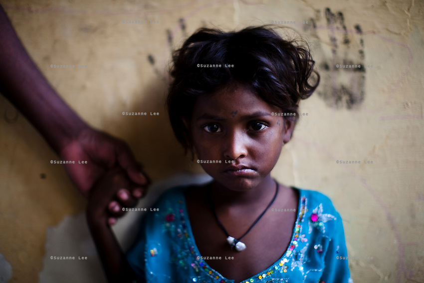 Underaged rape victim Mammarani, aged 6, now lives in the 3 story abandoned building that has been made into the Motiakhan Shelter for homeless people, in Paharganj on 5th October 2010, in Old Delhi, India. She was left behind, during the confusion when the police chased the homeless people out of their homes 2 weeks ago, and was gang raped. Picture: Suzanne Lee for The Australian.