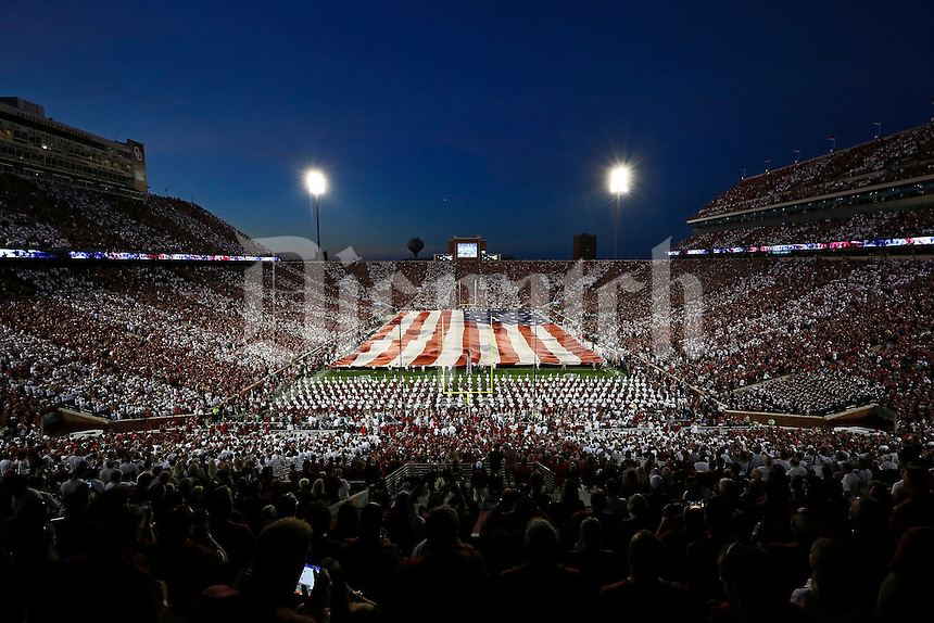 The National Anthem is performed prior to the NCAA football game between the Oklahoma University Sooners and the Ohio State Buckeyes at Memorial Stadium in Norman, Oklahoma on Sept. 17, 2016. (Adam Cairns / The Columbus Dispatch)
