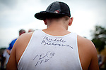 Republican presidential candidate, Rep. Michele Bachmann signed Zach Judd's shirt at a campaign stop held at a Pizza Ranch in Newton, Iowa, August 5, 2011.