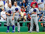 25 April 2010: Members of the Los Angeles Dodgers (left to right) Reed Johnson, Casey Blake, and Jamey Carroll stand at attention during the National Anthem prior to a game against the Washington Nationals at Nationals Park in Washington, DC. The Nationals shut out the Dodgers 1-0 to take the rubber match of their 3-game series. Mandatory Credit: Ed Wolfstein Photo