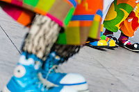 Clowns wear oversized colorful shoes during the Clown Congress in San Salvador, El Salvador, 18 May 2011. The clown performance is considered a regular job in most of Latin American countries. Clowns may work individually or in groups, often performing advertisement like acts in large open-to-street shops or they take part in private shows, like children birthdays, family events etc. There are many clown conventions all over Latin America where clowns gather and exchange their experiences offering workshops of the comic acting or the art of make-up. For some of them, being clown is a serious lifetime profession.