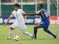 David Carranza (11) of Honduras tries to hold the ball away from Akeem Maloney (16) of Barbados during the group stage of the CONCACAF Men's Under 17 Championship at Catherine Hall Stadium in Montego Bay, Jamaica. Honduras defeated Barbados, 2-1.