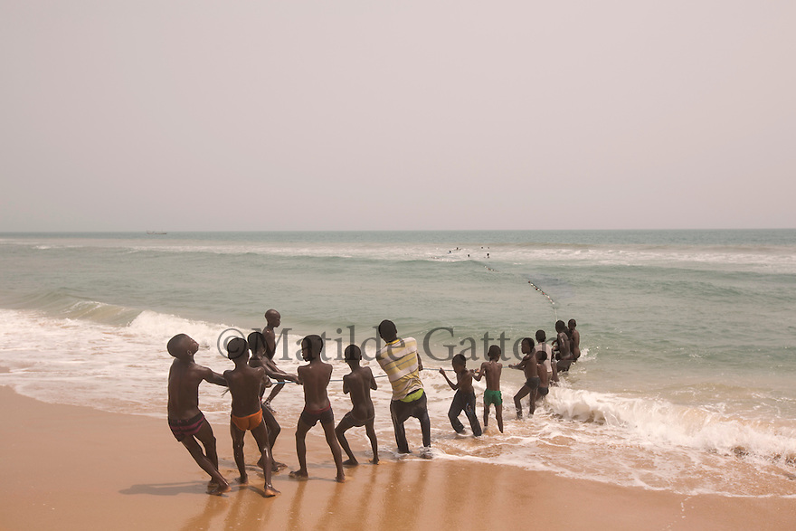 Ghana - Blekusu - Children learning traditional fishing techniques. A traditional fishing village, Blekusu lies just beside the sea defence which has been built in the nearby city of Keta. Although the groynes and sea defence wall are now protecting the city from erosion, they prevent sediments from reaching the coastline of Blekusu, resulting in massive erosion of the village coastline