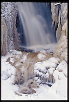 MINER'S FALLS IN THE PICTURED ROCKS NATIONAL LAKESHORE NEAR MUNISING MICHIGAN IN WINTER.