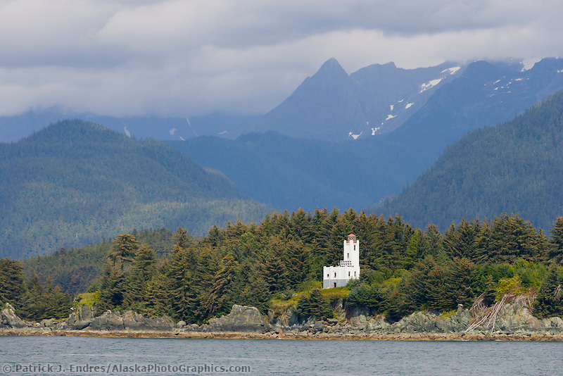 Historic Sentinel Lighthouse, located on Sentinel Island at the northern end of Favorite Channel, twenty-five miles northwest of Juneau. Coast mountains in the distance.