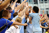 Roger Espinoza celebrates the opening goal with the Sporting KC fans... Sporting KC defeated Real Salt Lake 2-0 at LIVESTRONG Sporting Park, Kansas City, Kansas.