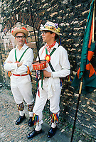 Traditional English Morris Men in costume with bells and floral hats at a Morris dancing festival in Cambridge, UK