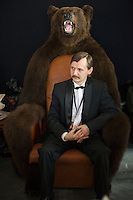 Moscow, Russia, 24/10/2009..A fur salesman on a chair made of bearskin at the Millionaire Fair in Moscow. The event has become an annual fixture, attracting thousands of would-be and existing Russian millionaires to view and purchase a wide range of luxury goods. This year however the fair was much smaller, an indication of how the formerly booming Russian economy has been hit by the world financial crisis.
